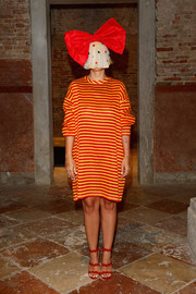 Sia brought a bright pop to the Miu Miu Women's Tales dinner with this red and yellow striped dress from the brand.
