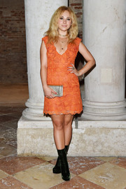 Juno Temple was retro-chic in dark-green platform boots and an orange mini dress at the Miu Miu Women's Tales dinner.