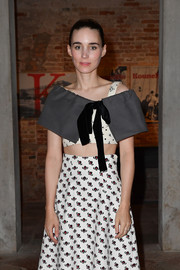 Rooney Mara layered a gray capelet over a printed crop-top for the Miu Miu Women's Tales dinner.