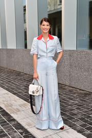 Hanneli Mustaparta brought some pajama glamour to the Prada private dinner with this pastel-blue and red blouse and pants ensemble.
