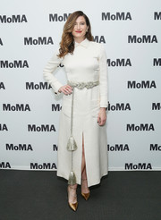 Kathryn Hahn styled her dress with gold ankle-strap  ADEAM 'High Heel Mary Jane' pumps.