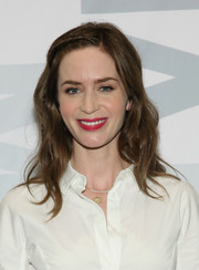 Emily Blunt swiped on some red lipstick for a bold pop of color to her look.