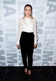 Saoirse Ronan paired her blouse with high-waisted black slacks, also by Laura Basci.