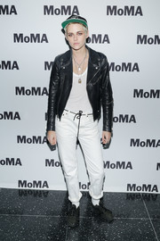 Kristen Stewart teamed white boyfriend jeans with a black leather jacket for the MoMA screening of 'Come Swim.'