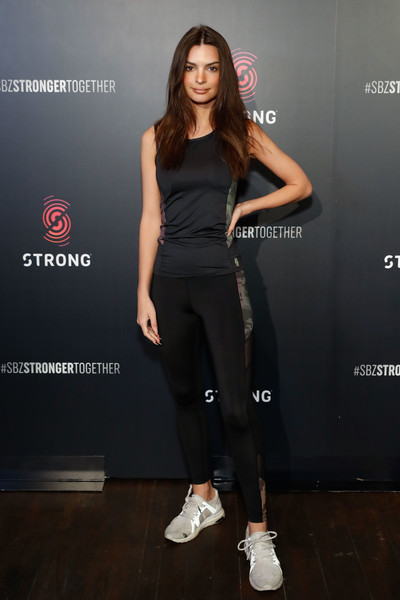 Emily Ratajkowski attended the STRONG by Zumba High-Intensity Workout Class wearing a fitted black tank top.