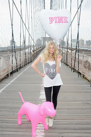 Elsa Hosk looked cozy-chic in this heart-print Pink shirt.