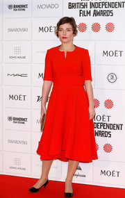 Camilla Rutherford donned a simple dress in a vivid red hue for the Moet British Independent Film Awards.