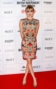 Christine Bottomley chose a busy-looking floral sheath dress for her Moet British Independent Film Awards look.