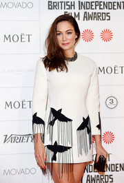 Anna Skellern attended the Moet British Independent Film Awards wearing a white mini dress with fringed bird accents.
