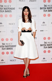 Gemma Chan paired her trendy top with a matching A-line skirt.