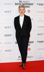 Maxine Peake styled her suit with modern-chic tricolor booties.