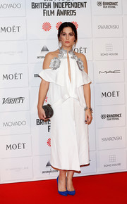 Phoebe Fox chose a loose white cold-shoulder dress with floral embellishments along the neckline for her Moet British Independent Film Awards look.