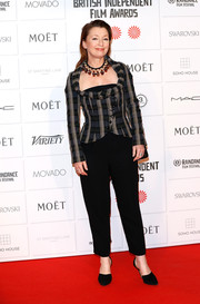 Lesley Manville layered a fitted plaid jacket over a black jumpsuit for her Moet British Independent Film Awards look.