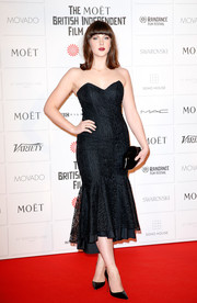 Alexandra Roach added a playful touch with a black Lulu Guinness lip clutch.
