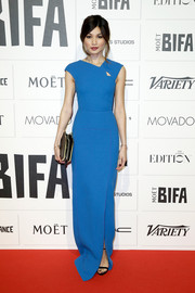 Gemma Chan attended the Moet British Independent Film Awards wearing an impeccably tailored Roland Mouret gown with a tiny cutout on the yoke.