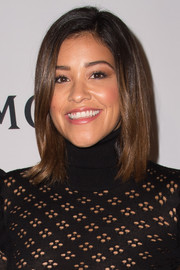 Gina Rodriguez wore her hair down to her shoulders in a simple straight style when she attended the Moet Moment Film Festival.