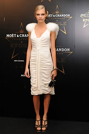 Cara Delevingne paired her elegant dress with a contrasting strappy platforms at the Moet & Chandon Etoile Awards.