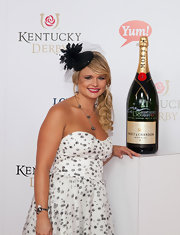 Miranda Lambert topped off her dotted dress with this black lace fascinator at the Kentucky Derby.