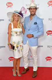 Caroline Boyer's print dress and feathered hat at the Kentucky Derby Moet & Chandon toast were a fab pairing.