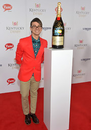 Christian Siriano paired neutral chinos with a bright orange blazer for the Kentucky Derby Moet & Chandon toast.