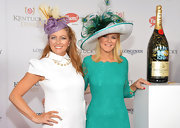 A feathered purple fascinator added lots of flair to Taunya Eshenbaugh's look during the Kentucky Derby Moet & Chandon toast.