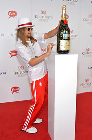 Robert James Ritchie went for a sporty look with red sweatpants and a white polo shirt at the Kentucky Derby Moet & Chandon toast.