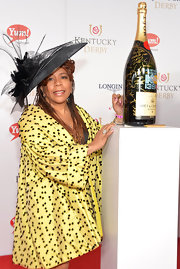 Valerie Simpson wore a dramatic black decorative hat to the Kentucky Derby Moet & Chandon toast.