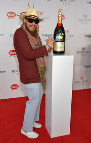 Nicholas David paired pastel blue slacks with a maroon blazer for his Kentucky Derby red carpet look.