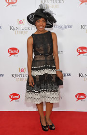Angela Bassett looked enchanting in a black-and-white lace-overlay dress at the Kentucky Derby Moet & Chandon toast.