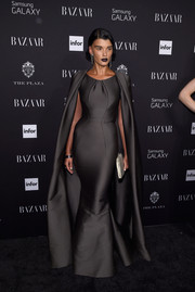 Crystal Renn went for Old Hollywood drama in a caped gray mermaid gown by Zac Posen during the Harper's Bazaar Icons event.