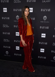 Lily Aldridge went for a rocker edge in a red Emilio Pucci velvet pantsuit, which she teamed with an orange blouse for a striking mix of colors.