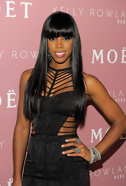 Kelly Rowland styled her shiny locks in a sleek 'do for the launch of her new album, 'Here I Am.'