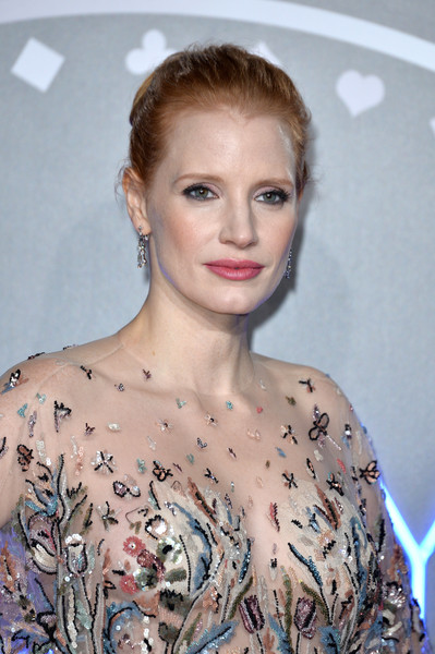More Pics of Jessica Chastain Classic Bun (1 of 23) - Jessica Chastain Lookbook - StyleBistro [photo,hair,face,hairstyle,lip,eyebrow,shoulder,beauty,blond,fashion,chin,red carpet arrivals,jessica chastain,mollys game uk,caption,vue west end,london,getty images,premiere,premiere]