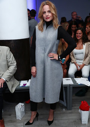 Mena Suvari was fall-chic in a gray wool dress layered over a turtleneck and trousers at the Momentum by Timo Weiland show.