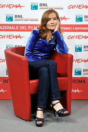 Isabelle Huppert's black patent leather platform sandals were a sexy way to finish off her prim outfit at the 'Mon Pire Cauchemar' photocall.