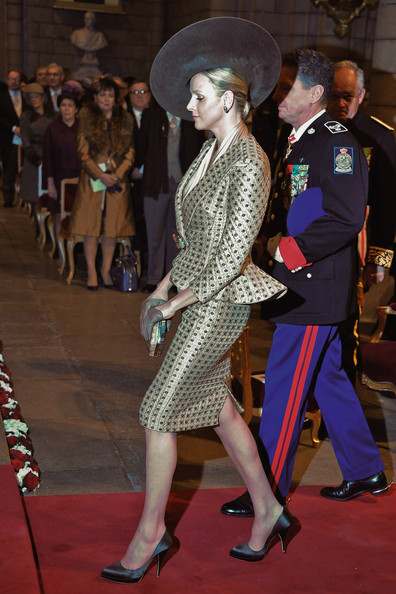 Charlene Wittstock attended mass in silver satin pointy toe pumps. The heels looked fab with gray leather gloves and a matching hat.