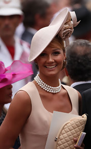 Attending the Monaco Royal Wedding of Prince Albert II and Princess Charlene, Franziska van Almsick exuded a classic elegance wearing this stunning three-strand polished pearl necklace.