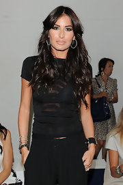 Elisabetta wore her raven  hair in long tousled waves at a runway show during 2013 Milan Fashion Week.