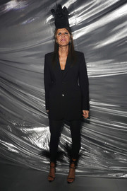Anna dello Russo hit the Moncler Genius fashion show wearing this black blazer and skinny pants combo.
