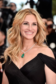 Julia Roberts paired her off-the-shoulder dress with a stunning gemstone pendant necklace by Chopard.
