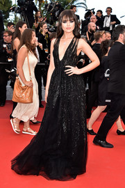 Kristina Bazan put on a daring display in a low-cut black gown by Elie Saab at the Cannes premiere of 'Money Monster.'
