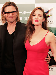 Angelina Jolie attended the Japanese premiere of 'Moneyball' wearing a sexy sweep of red lipstick.