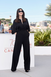 Monica Bellucci went for simple sophistication in a black Stella McCartney jumpsuit at the Cannes Film Fest Mistress of Ceremonies photocall.