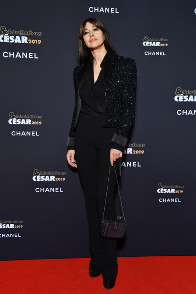 Monica Bellucci Slacks [clothing,red carpet,carpet,suit,fashion,premiere,formal wear,footwear,pantsuit,dress,cesar - revelations,monica bellucci,at petit palais in paris,paris,france,le petit palais,january 14]