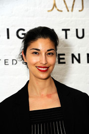 Caroline Issa gave her black look a pop of color with a swipe of red lipstick.
