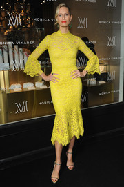 Karolina Kurkova was a style standout in a canary-yellow Lela Rose lace dress with a fluted hem and sleeves at the Monica Vinader Soho boutique launch.