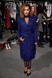 Naya Rivera looked super sophisticated in a cobalt and black tweed coat layered over a tulle jumpsuit, both by Monique Lhuillier, during the label's fashion show.