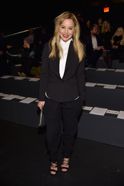 Abbie Cornish teamed a sleek blazer with black harem pants for the Monique Lhuillier fashion show.