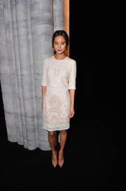 Jamie Chung looked supremely elegant in an embroidered white cocktail dress by Monique Lhuillier during the label's fashion show.