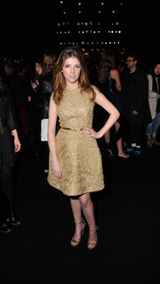 Anna Kendrick looked divine in a textured gold Monique Lhuillier cocktail dress during the label's fashion show.